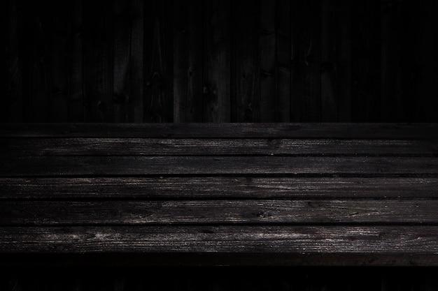 暗い木製のテーブル背景