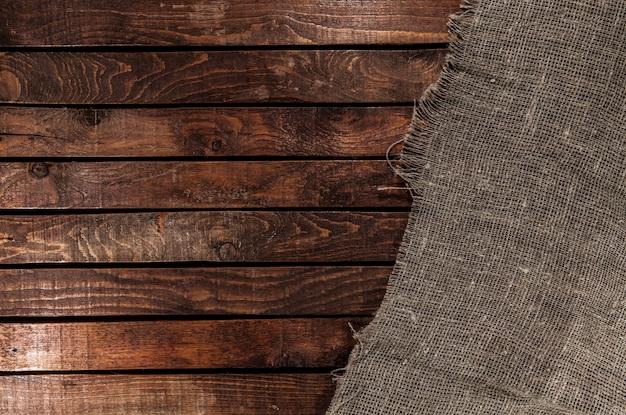 木製のテーブルの黄麻布の質感