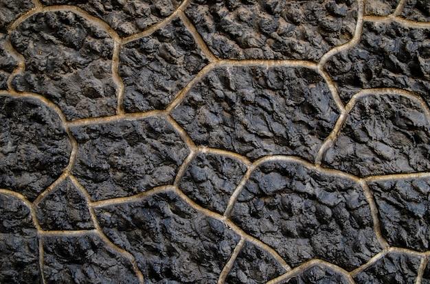 石の壁で作られた背景。