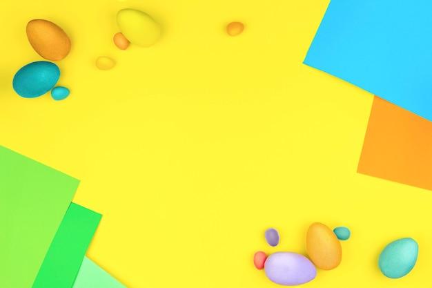 Счастливой пасхи концепция. красочные пасхальные яйца на желтом фоне с зелеными синими оранжевыми рамками
