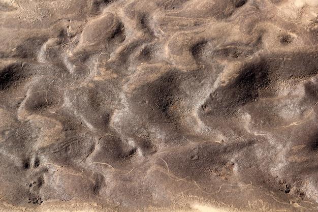 濡れた砂と粘土の抽象的な背景テクスチャ