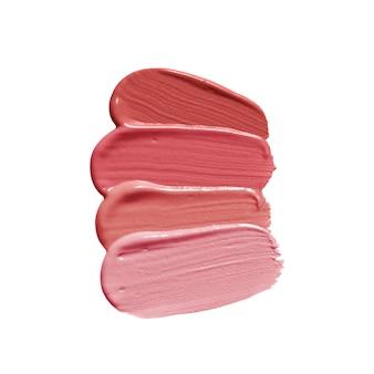 分離した裸色のさまざまな色合いの口紅ブラシストローク