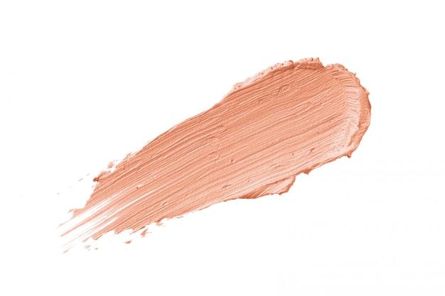 Персиковый цвет, корректирующий мазок на консилер, изолированный