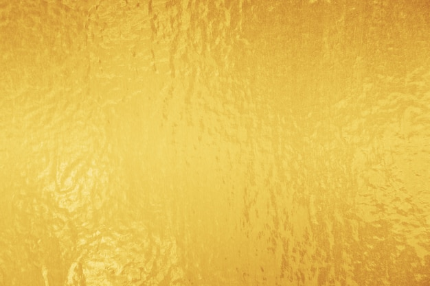黄金の光沢のある箔のテクスチャ