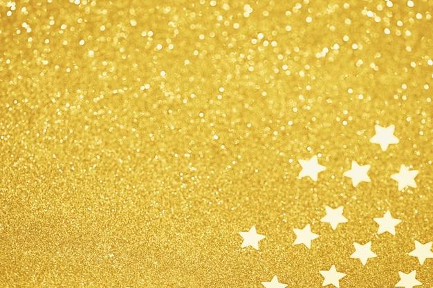 Золотая звезда конфетти размытым блеском украшения