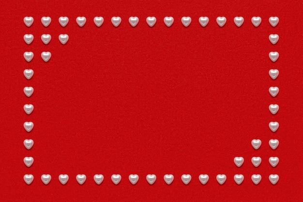 赤いベルベットのベロア紙にパールハートフレーム