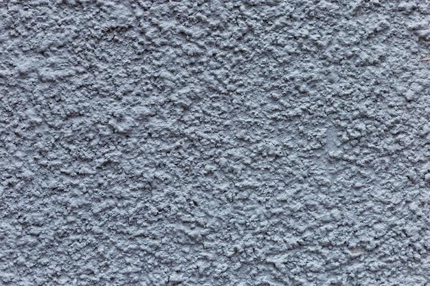 漆喰の青い壁のテクスチャ