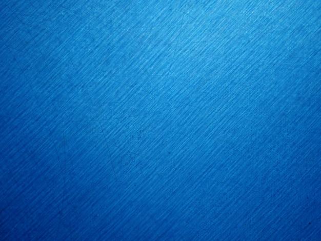 抽象的なグランジの装飾的な装飾的な青い暗い壁グラデーションカラーの抽象的な背景