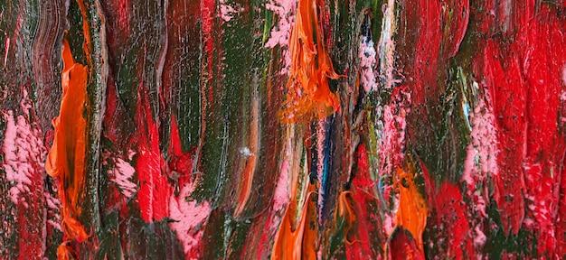 キャンバスにブラシストロークのカラフルなアートの抽象的な背景とテクスチャ。