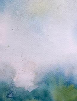 ホワイトペーパーの柔らかい抽象的な背景の水彩画と織り目加工。