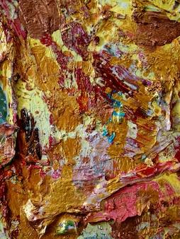 壁の金のカラフルな背景と織り目加工。