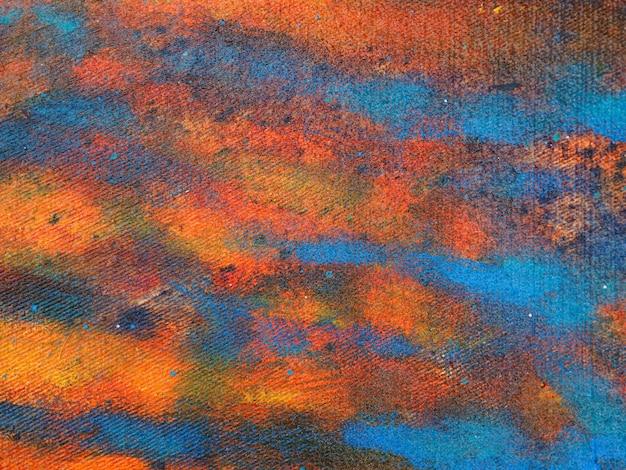 カラフルな油絵手は抽象的な背景を描画します。