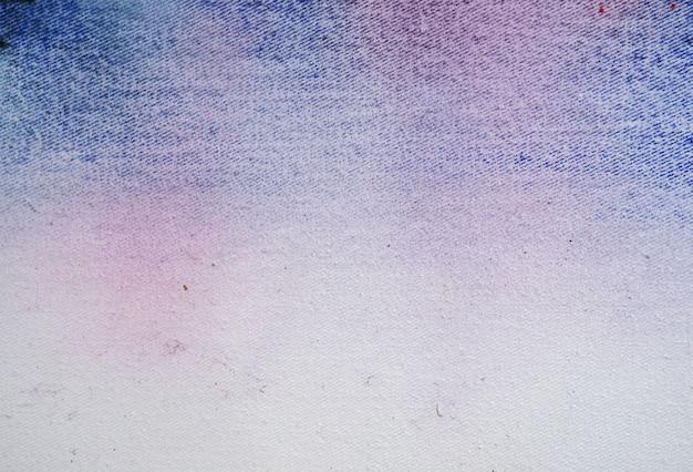 水彩の甘い色の抽象的な背景が落ちる。