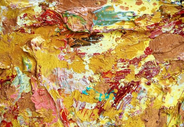 ゴールドのカラフルなオイルペイントの背景色と質感。