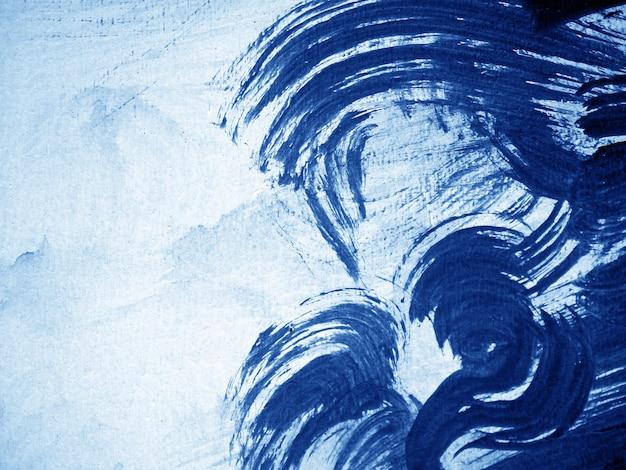 青い濃い油絵の具の抽象的な背景。