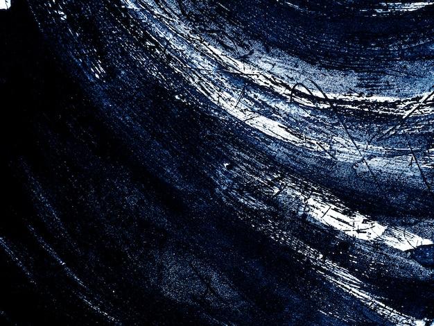 濃い青と白のブラシストロークテクスチャの抽象的な背景。