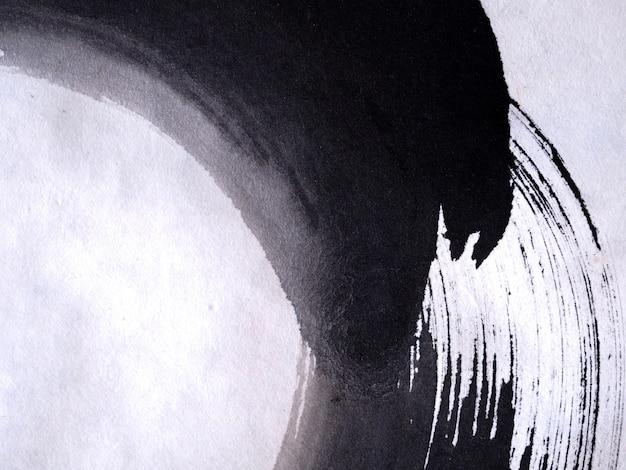 手描きペイントブラシブラックカラーテクスチャの抽象的な背景。