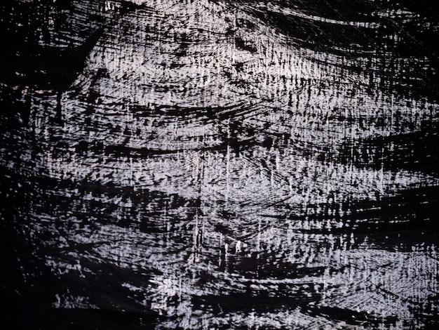 黒と白のペイントブラシストロークの油絵