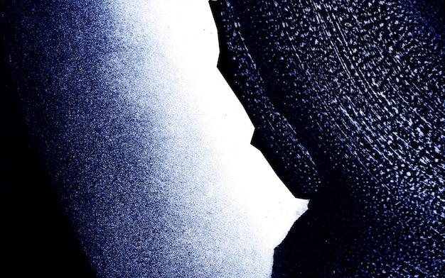 青の暗いと白のブラシストロークテクスチャの抽象的な背景。