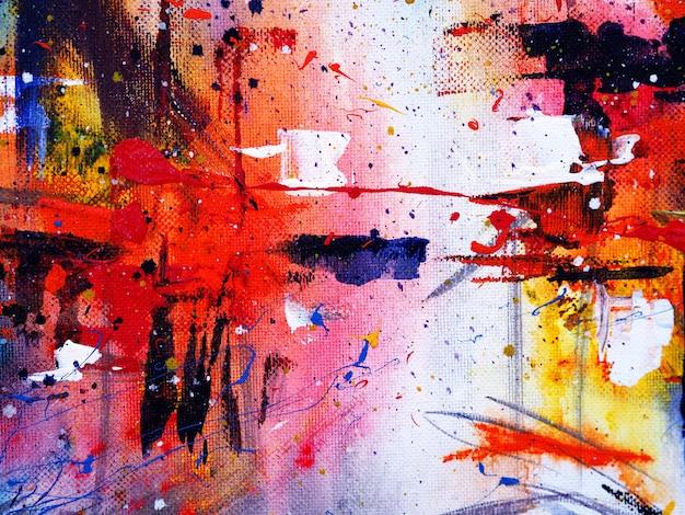 手は、テクスチャとカラフルな水彩画の抽象的な背景を描きます。