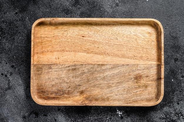 木製アンティークトレイ。黒のテクスチャ背景。上面図。コピースペース