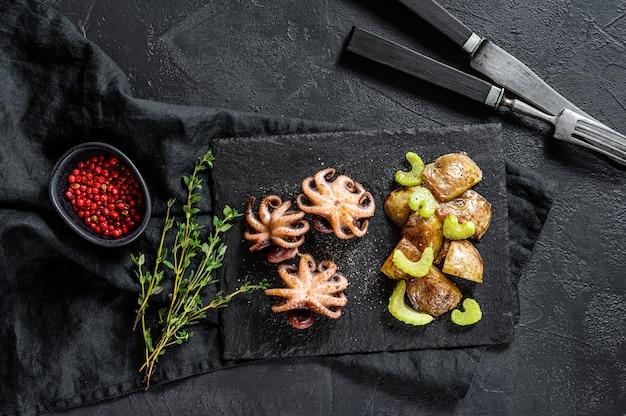 Жареный осьминог. запеченный картофель и сельдерей.