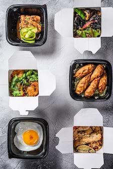 Еда на вынос. спринг роллы, пельмени, гёза и вок лапша. здоровый обед возьми и иди натуральные продукты. ,