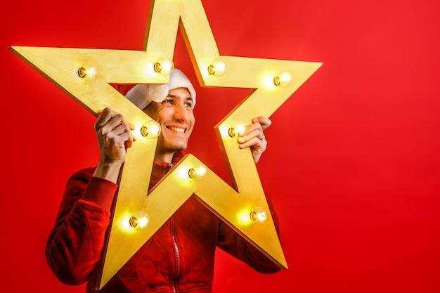 クリスマスの電気スターの赤のサンタクロース