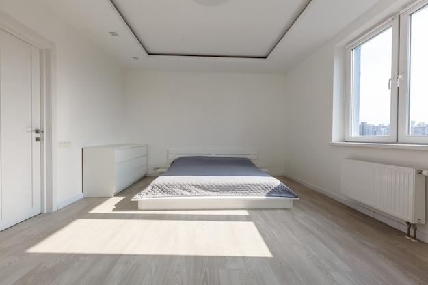 白い寝室のレンダリング
