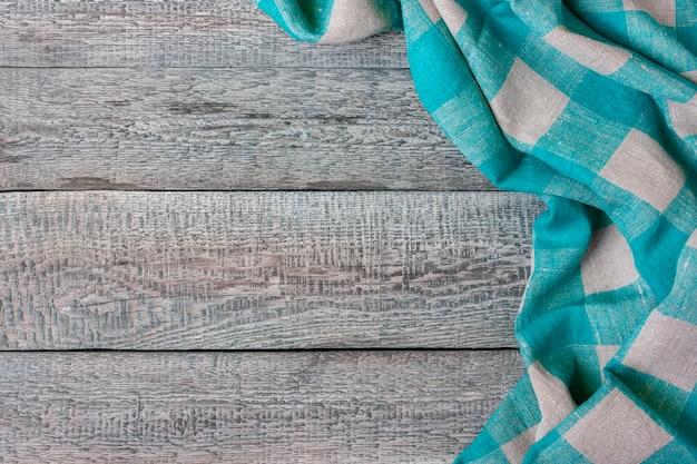 木の板に格子縞生地