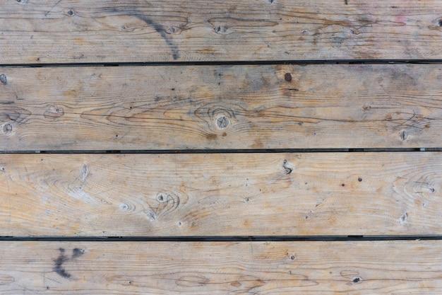 スポットと茶色の木製の背景。テクスチャ。