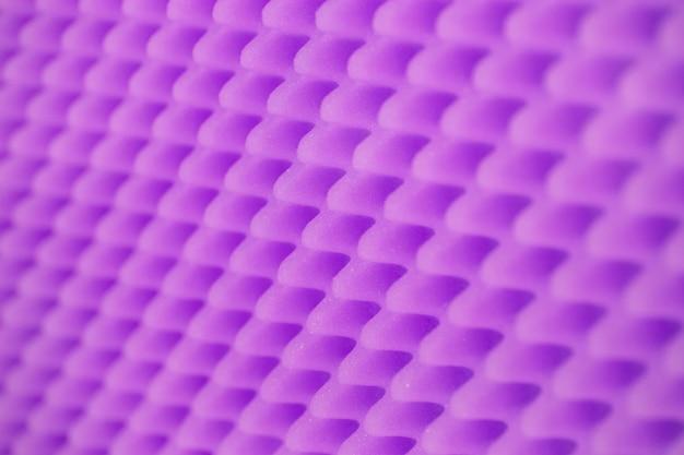 色の発泡ゴムの背景。