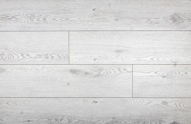 ラミネートの背景。インテリアデザインの床用の木製ラミネートと寄木細工のボード。天然木の質感と模様