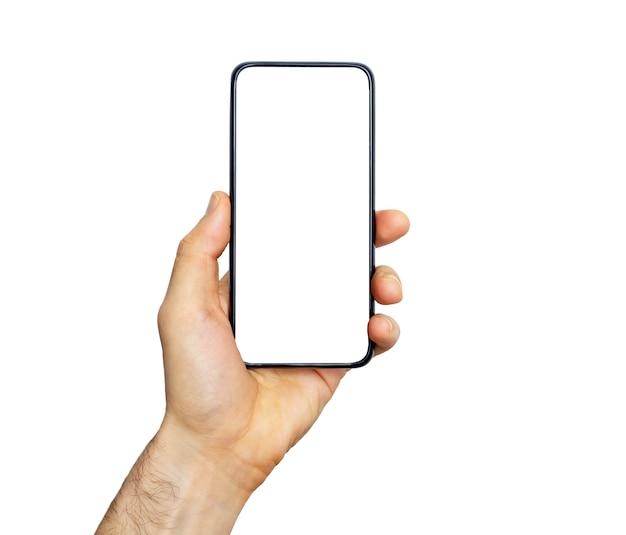 手でスマートフォン(電話)空の画面。白い背景上に分離されて黒のスマートフォン。画像とデザインの空白の電話画面