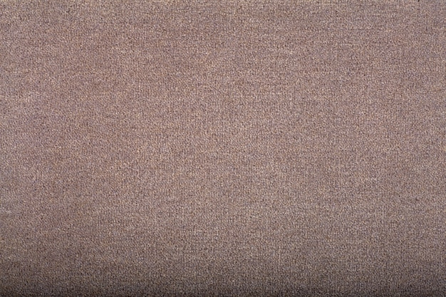 背景を覆うカーペット。明るい茶色のカーペットの模様と質感。コピースペース