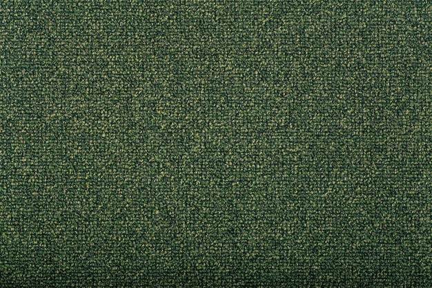 背景を覆うカーペット。緑の色のカーペットのパターンと質感。コピースペース