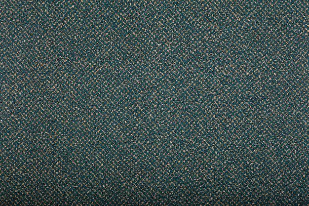 背景を覆うカーペット。濃い緑色のカーペットの模様と質感。コピースペース