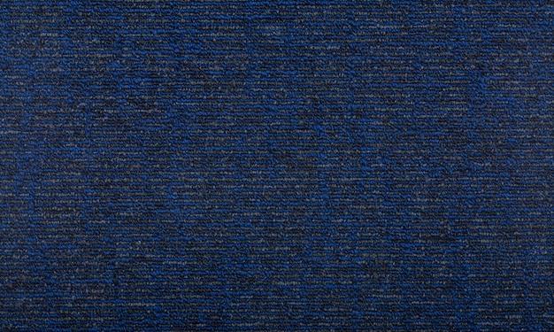 背景を覆うカーペット。青い色のカーペットのパターンとテクスチャー。コピースペース