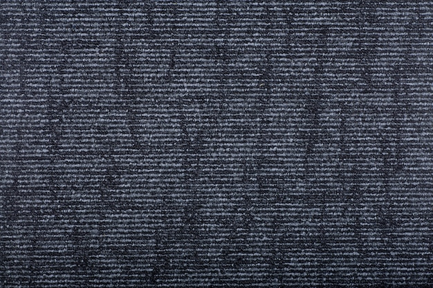 背景を覆うカーペット。黒い色のカーペットの模様と質感。コピースペース