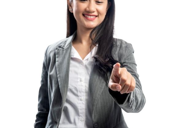 何かを指している美しいアジアビジネス女性