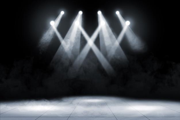 コンサートスポットの照明と煙のタイル張りの床