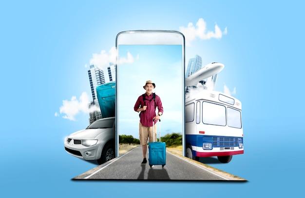 スーツケースバッグと路上に立っているバックパックと帽子のアジア人