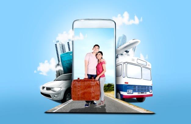 路上に立っているスーツケースバッグを運ぶアジアカップル
