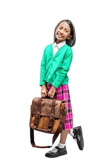 スーツケースと幸せな表情に立っているアジアのかわいい女の子
