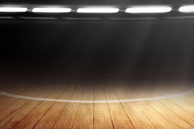 木製の床とスポットライトのバスケットボールコートのクローズアップ