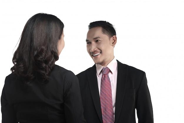 ビジネスの男性と女性が手を振る
