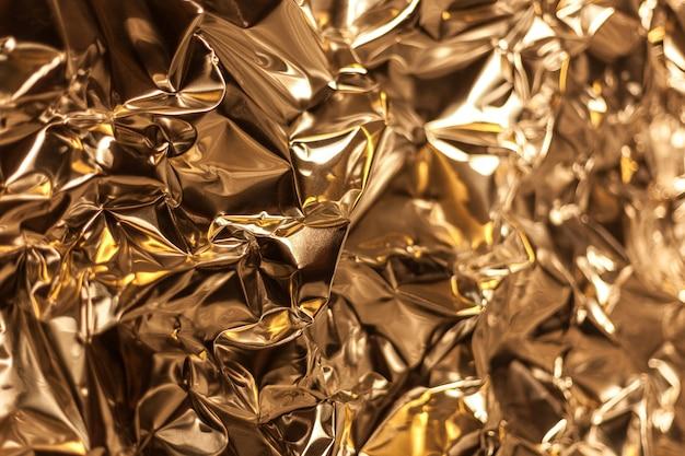 しわくちゃの銀アルミ箔のシートのフルフレームテイク