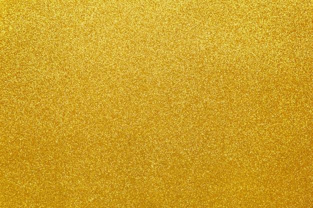 Золотой сверкающий праздничный фон, крупный план
