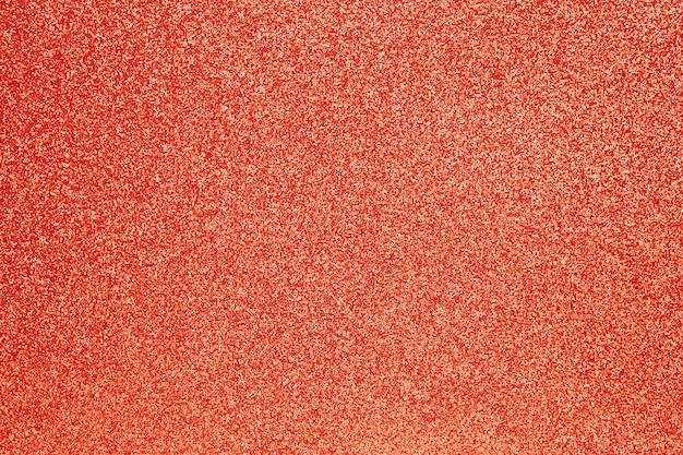 Красный сверкающий праздничный фон, крупный план
