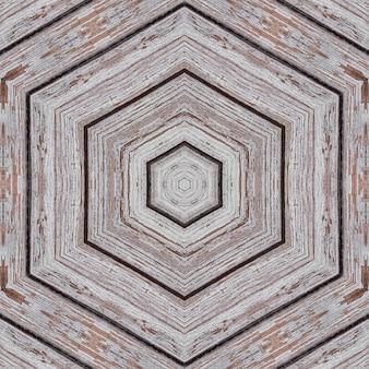 六角形と菱形と線の形の木製の板の例示的なパターン。
